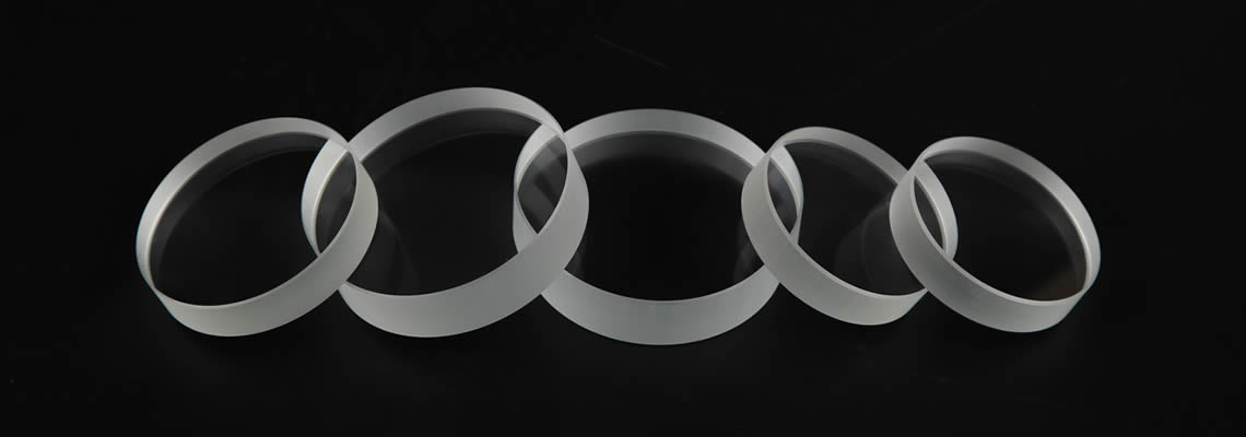 Five optical glass are placed on the black background and with different sizes.