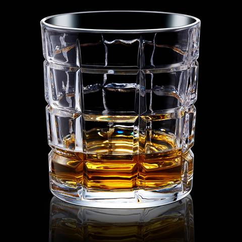 The type D whiskey glass cup is filled with whiskey wines.