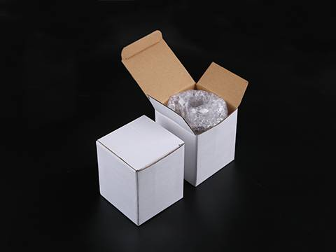 Two white box and one shows the glass cup packed with bubble film.