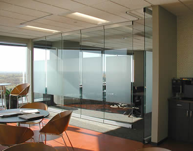 The room is separated into two parts by glass partition wall.