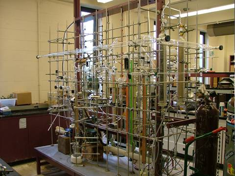 The laboratory equipment with glass pipes is in the biological laboratory.