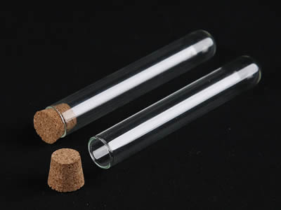 A closed and an opened glass test tube with cone shape cork stopper on the black background.
