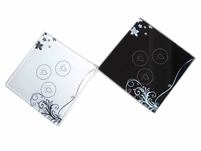 A white and a black glass touch switch with stars and plants pattern on the corner.