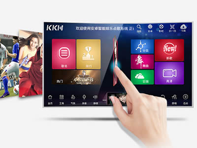 A finger is pressing button on the KTV smart panel.