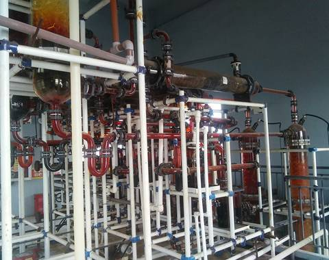 This is a pharmaceutical factory with the huge distillation equipment that contains glass tube condenser.