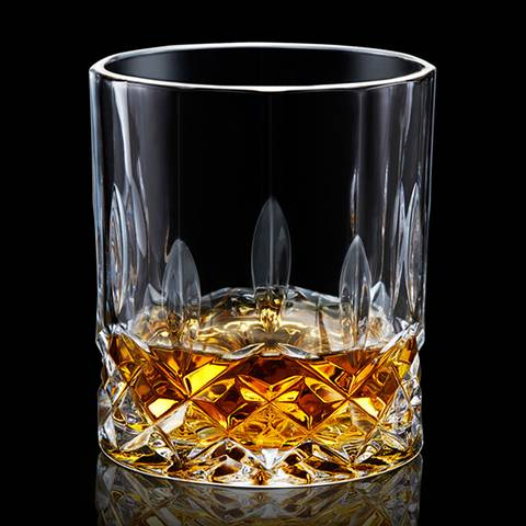The type H whiskey glass cup is filled with whiskey wines.