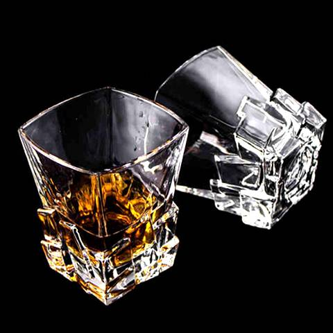 There are two ice shaped whiskey glass cups.