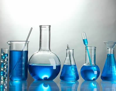 There are nine kinds of lab glassware with blue liquid in them.