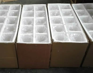 Many glass flasks with foam wrapped are in five cartons.